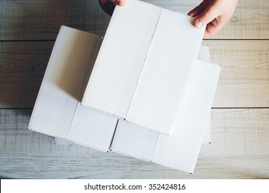 Beautiful package lying on the table. White boxes.