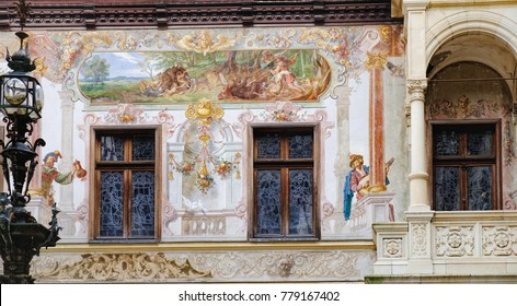 Beautiful paintings on the walls, balcony with frescoes and stained glass windows of Peles Castle, Sinaia, Romania. Peles Castle is one of the most important and beautiful monuments in Europe