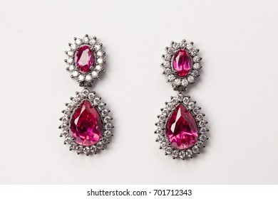 A beautiful pair of earrings isolated on a white background