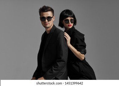 Beautiful pair of sunglasses lifestyle luxury relationship embrace