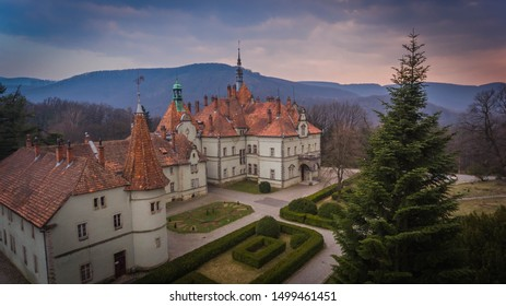 Beautiful palace with spiky towers and decorated walls in mountains at sunset