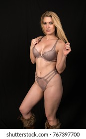 Beautiful pale blonde in mauve lingerie