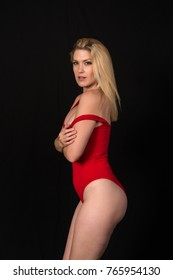Beautiful pale blonde in a red one piece swimsuit