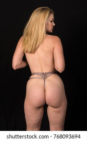 Beautiful pale blonde topless in mauve panties