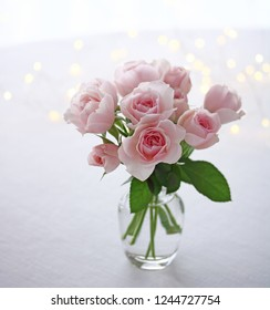 Beautiful pale pink rose flowers in a glass vase