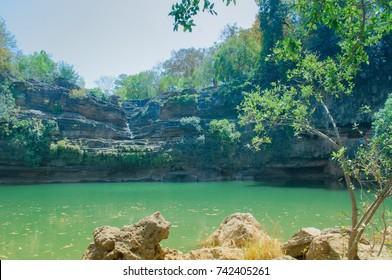 Beautiful Pandav falls lake at Panna National Park, Madhya Pradesh, India. It is located in Panna and Chhatarpur districts of Madhya Pradesh in India. It has an area of 542.67 km2, a tiger reserve.