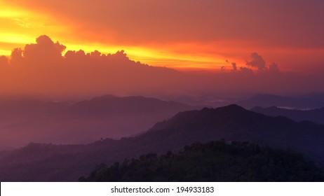 Beautiful of PanoenThung view point with fog at sunset in Kaeng Krachan national park, Petchaburi,Thailand