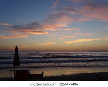 beautiful panorama after sunset seen from the beach of viareggio in italy
