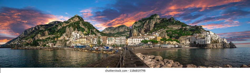 Beautiful panorama of Amalfi, the main town of the coast on which it is located taken from the sea. Situated in province of Salerno, in the region of Campania, Italy, on the Gulf of Salerno at sunset