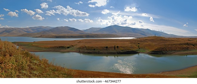 beautiful panorama with ancient cemetery on the hill and lake, Armenia  Perfect background for a text