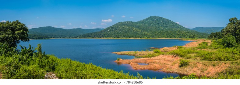 Beautiful panorama of the clear blue Burudih lake and adjoining mountains in Ghatsila, Jharkhand, India.