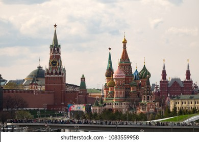 Beautiful panorama day view of Moscow Kremlin with Saint Basil's Cathedral over the console bridge of the park Zaryadie