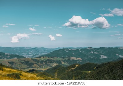 Beautiful panorama of European wild nature.Wide mountain landscape in autumn.Instagram vintage film filter with vibrant green color.Travel destination for active tourism in Europe.Green hills foresty