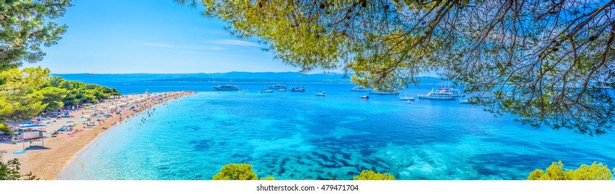 Beautiful panorama of famous Adriatic beach Golden Cape (Zlatni Rat), Island of Brac Croatia summertime. / Famous Adriatic beach Croatia. / Selective focus.