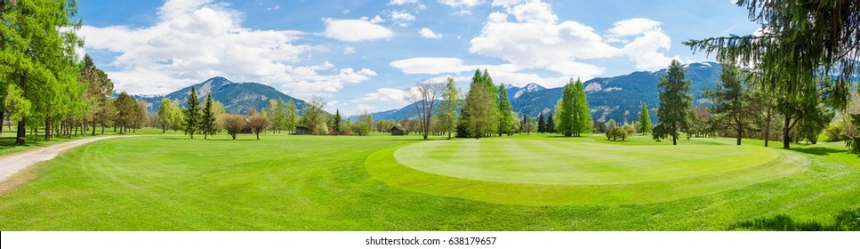 Beautiful panorama of golf course and Alps in Austria. Golf course in summer with mountains in background.