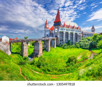 Beautiful panorama of the Hunyad Castle / Corvin's Castle with wooden bridge. Fantastic summer sunrise in Hunedoara, Transylvania, Romania, Europe
