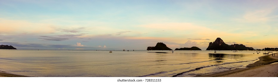 beautiful panorama landscape of sea at the beach at dusk in evening when sunset with golden light with mountain, blue sky and cloud  background. sky and sea twilight.