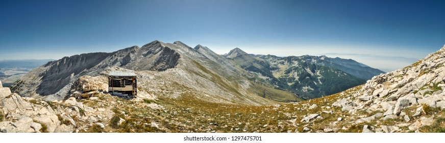 Beautiful panorama of mountainous landscape in Bulgaria  with mountains shelter on sunny summer day.