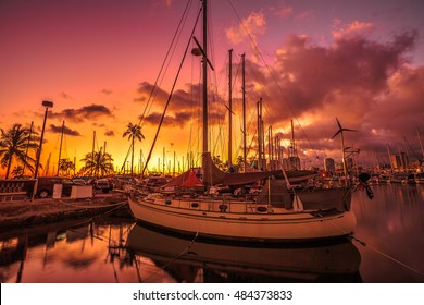 Beautiful panorama of sailing boats docked at the Ala Wai Harbor at sunset the largest yacht harbor of Hawaii, situated between Waikiki and downtown Honolulu in Oahu, Hawaii.