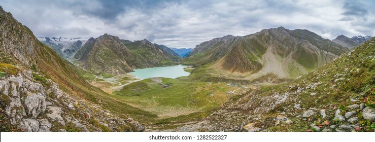 Beautiful panorama of Sheshnag lake in Kashmir mountains in India on cloudy day.