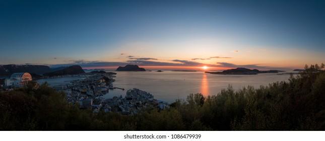 Beautiful Panorama sunset of coastal city. Nature scenes of Norway, Aalesund.