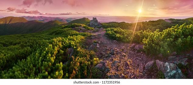Beautiful panorama of sunset in the mountains. Sakhalin island. Chekhov peak.