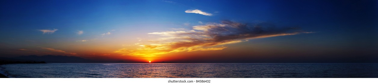 Beautiful panorama of sunset in the sea