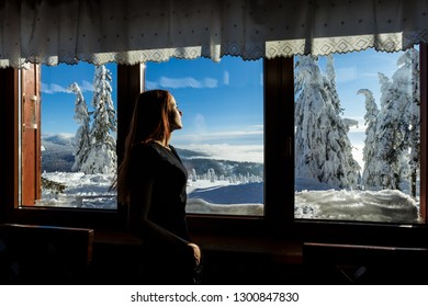 Beautiful panorama taken in polish mountains Beskidy in  the shelter on Rysianka during snowy winter. Landscape  captured during from window.