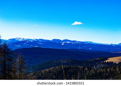 beautiful panorama of top the dolomites in Asiago, in the Italian Alps on a sunny end of winter