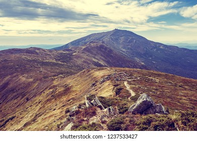 Beautiful panorama view in autumn.Dramatic clouds over Carpathian mountains range in sunny day.Highland path on mountain top.Go hiking in Carpathians, popular place for active tourism in Europe