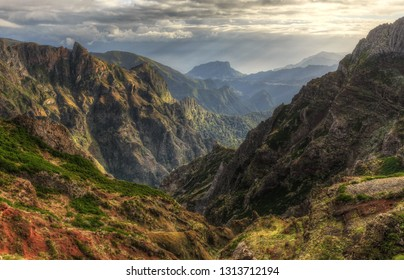 Beautiful panorama view of the landscape in the mountains of Madeira at Pico do Areeiro (Arieiro) while hiking to Pico Ruivo on a cloudy summer day