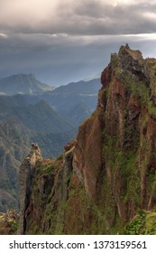 Beautiful panorama view of the landscape in the mountains of Madeira at Pico do Areeiro (Arieiro) while hiking to Pico Ruivo on a cloudy summer day with the buzzards nest viewpoint
