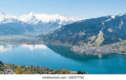 Beautiful panorama view over Zell am See lake in summer. Nature panorama of snowy Tirol Alps in Austria with lake Zeller.