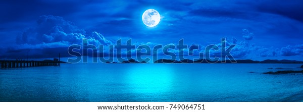 Beautiful colorful blue sky with cloud and bright full moon serenity nature wallpaper mural