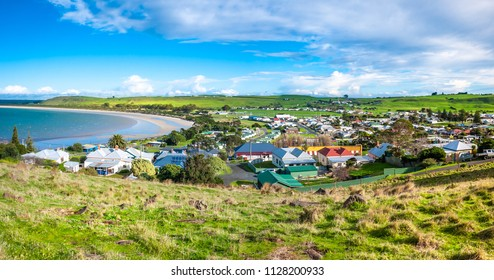 Beautiful panorama view of Stanley's residential houses in town and coast line against blue sky on a bright sunny day. Elevated view from 'The Nut' - a volcanic plug in Stanley, Tasmania, Australia