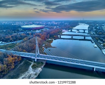 Beautiful panoramic aerial dsron view to Swietokrzyski Bridge (Polish: Swietokrzyski) and The PGE Narodowy or National Stadium - football stadium located in Warsaw, Poland, from dron DJI Mavic Air