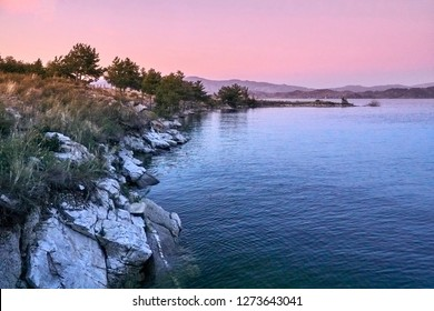 Beautiful panoramic aerial summer view at sunset to the Bukhtarma artificial reservoir, formed by the dam of the Bukhtarma hydroelectric station on the Irtysh river, Kazakhstan
