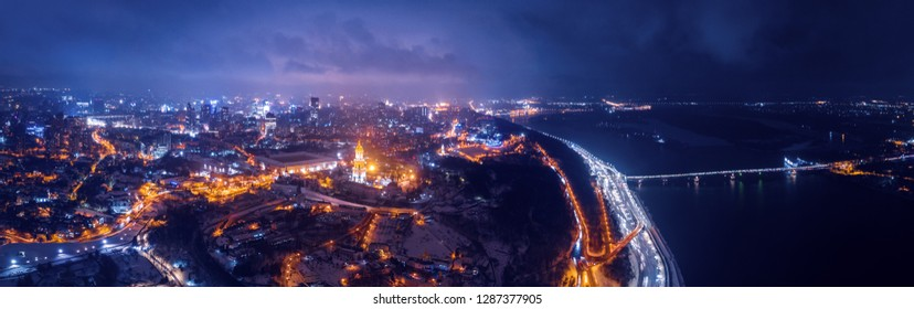 Beautiful panoramic aerial view of the center of Kiev with illuminated bridges across the Dnieper River, Kiev-Pechersk Lavra
