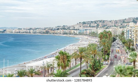 Beautiful panoramic aerial view city of Nice timelapse, France. Promenade with traffic on the road. Luxury resort of French riviera. Top view of the Mediterranean sea, bay of Angels. Cote d'Azur