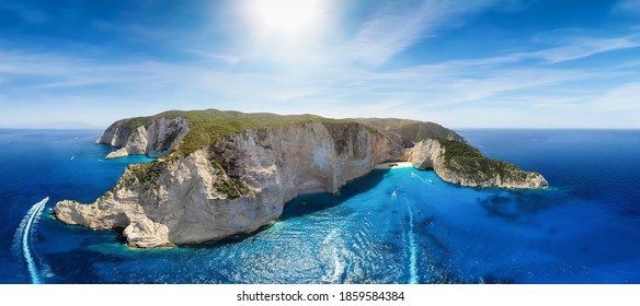 Beautiful panoramic aerial view to the famous Shipwreck Beach Navagio on Zakynthos island, Greece, with tourist boat traffic over the blue sea