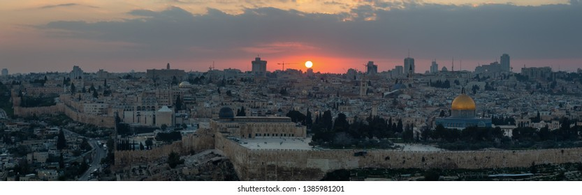 Beautiful panoramic aerial view of the Old City and Dome of the Rock during a dramatic colorful sunset. Taken in Jerusalem, Capital of Israel.