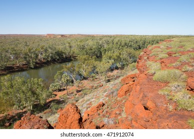 Beautiful panoramic Aerial view over outback river in Millstream Chichester National Park in Western Australia, with rocks, trees, summer sunny blue sky, copy space.