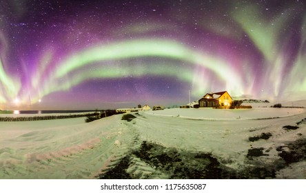 Beautiful panoramic Aurora Borealis or better known as The Northern Lights for background view in Iceland, Reykjavik during winter