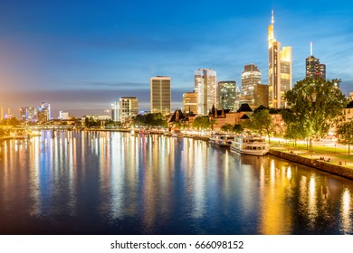 Beautiful panoramic cityscape view with illuminated skyscrapers during the twilight in Frankfurt, Germany
