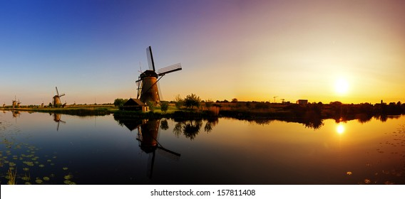Beautiful panoramic image of the dutch windmills at Kinderdijk, the Netherlands. An UNESCO world heritage site. HDR