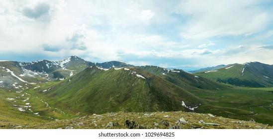 Beautiful panoramic landscape of Khakassian high mountains and cloudy sky