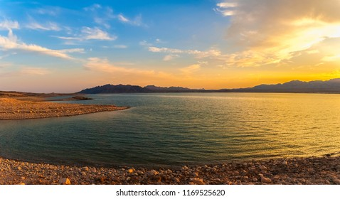 Beautiful panoramic landscape of the Lake Mead National Recreation Area from its muddy shore at sunset in summer, Nevada.