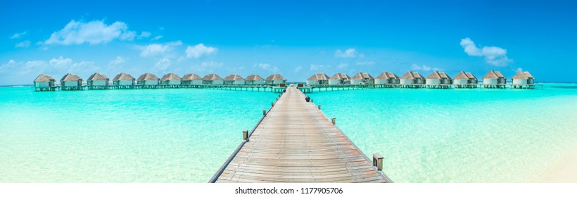 Beautiful panoramic landscape of over water villas, Maldives island, Indian Ocean