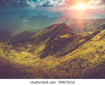 Beautiful panoramic mountain landscape at sunset. Filtered image:cross processed vintage effect.