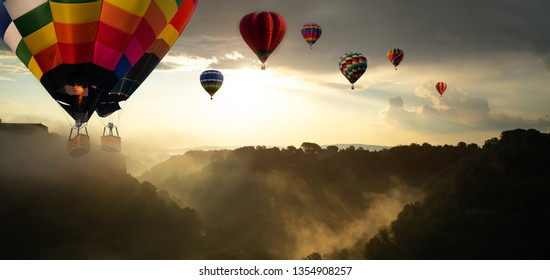 Beautiful panoramic nature landscape of countryside mountains with colorful high hot air balloons festival in summer sky. Vacation travel panorama background.